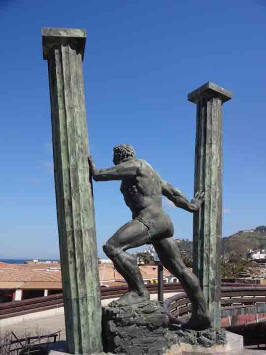 Ceuta-Pillars-of-Hercules-Plaza-de-la-Costitucion-statue-side-with-Mount-Hacho-in-background.jpg