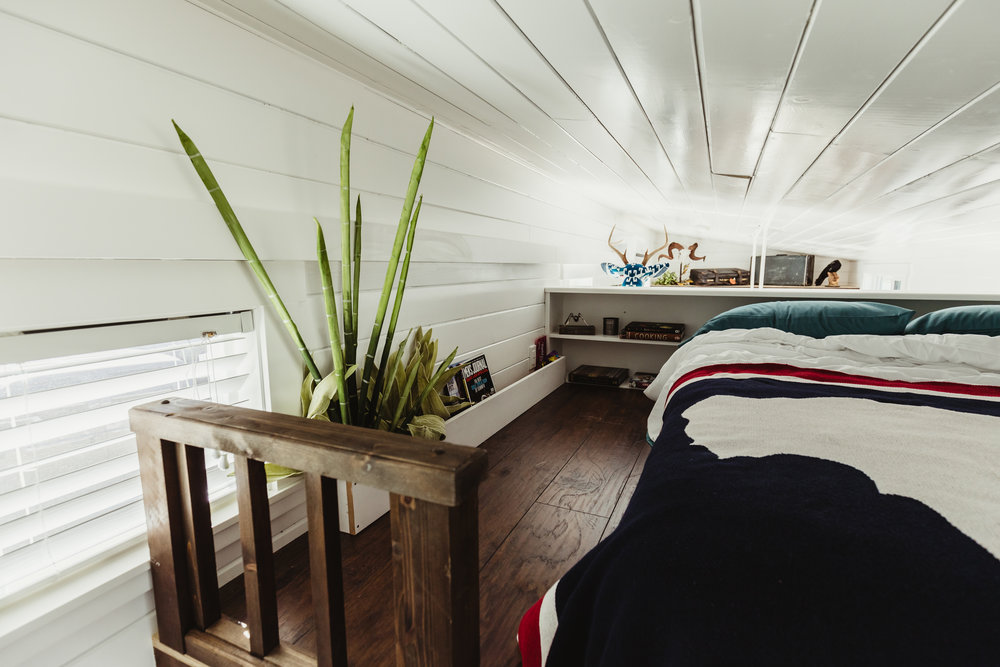 There is no denying the loft space is small. Creative touches like bold bedding without a lot of bulk, and bringing a bit of the outdoors in, keeps this space feeling just roomy enough!