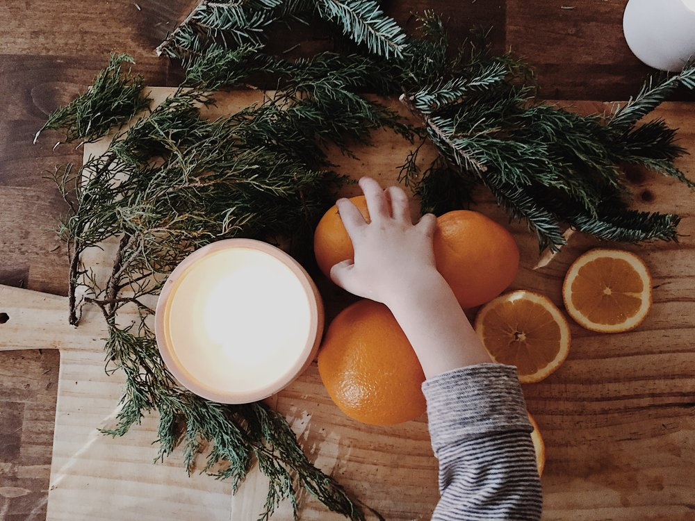 Eager little hands ready to help.  This is such a great project for little ones to join in on.  It's safe, natural & they can eat as they go!  Be sure and purchase a couple extra oranges if you have little helpers ;).