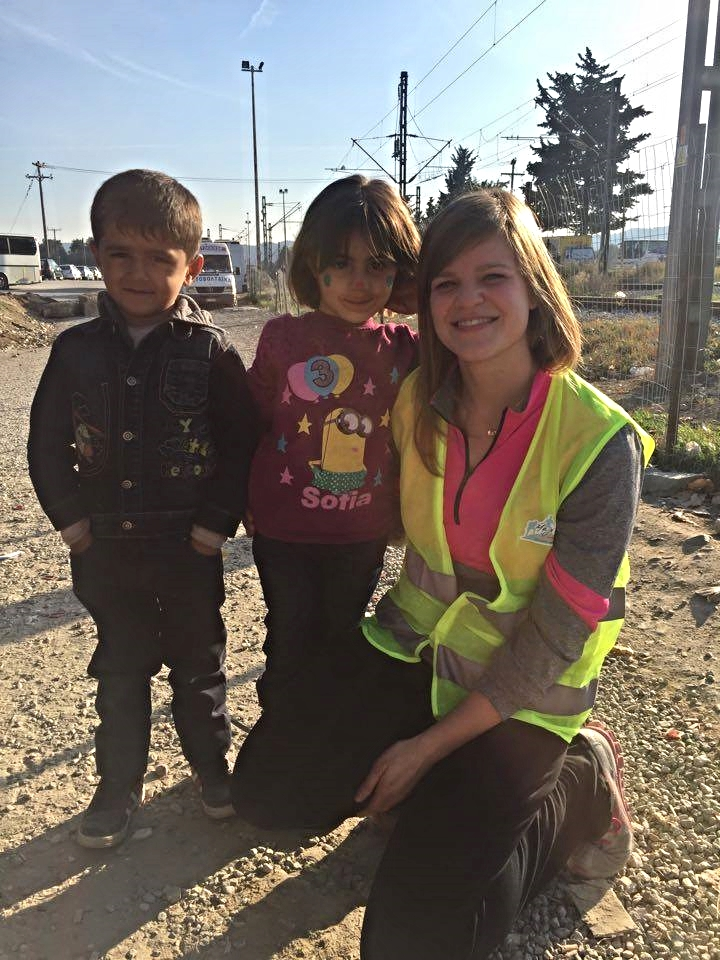 """This girl clung to me. She giggled and tugged at my pants. I cried so hard when I watched her walk toward the border."" Lindsey Mayberry"