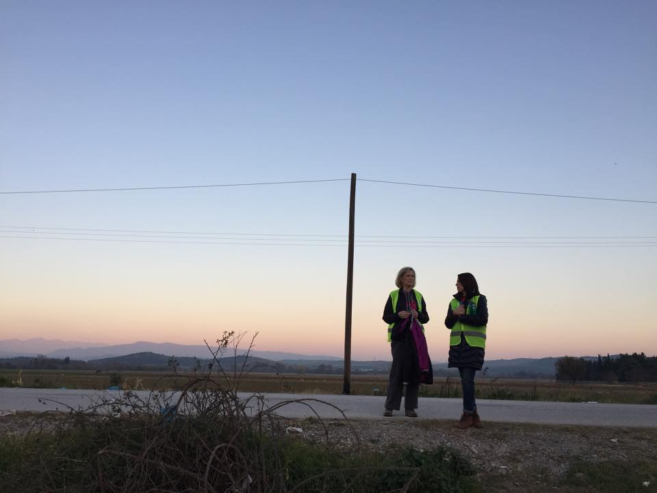 Karen Davis and Kari McGhee rest at sunset. They worked past midnight trying to comfort families as they tried to find warmth for the night.