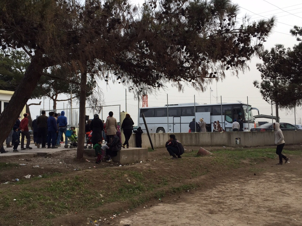 A bus filled with new arrivals to the camp