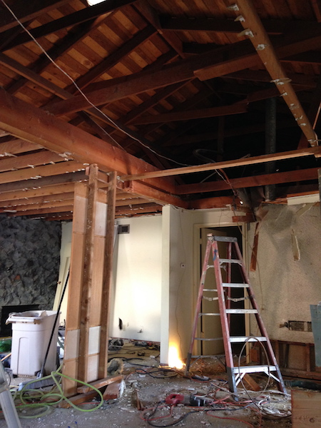 Ceiling joists removed, exposing the roof structure.