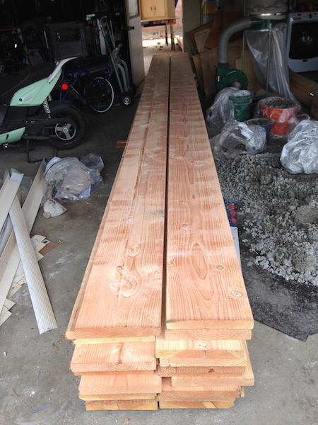 The wood for the new 2x12 rafters just barely fit in the garage.