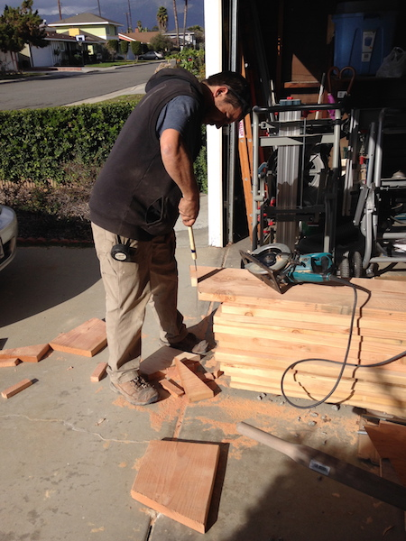 Christian notched the end of each new rafter to fit snugly against both the old ridge board and the new ridge beam.