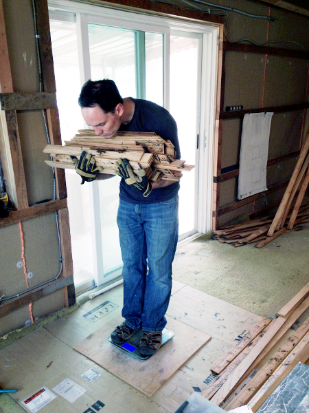 Chris weighing a bundle of flooring.