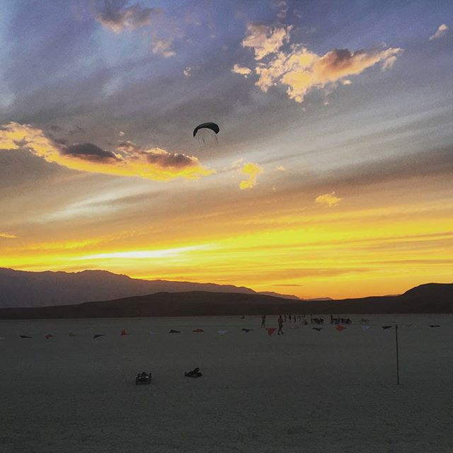 Burning man kiting. Photo credit @sebnchi #burningman #kitesurfing #kiteboarding #holycitykiteboarding #travel #sunset #fly #kitelessons