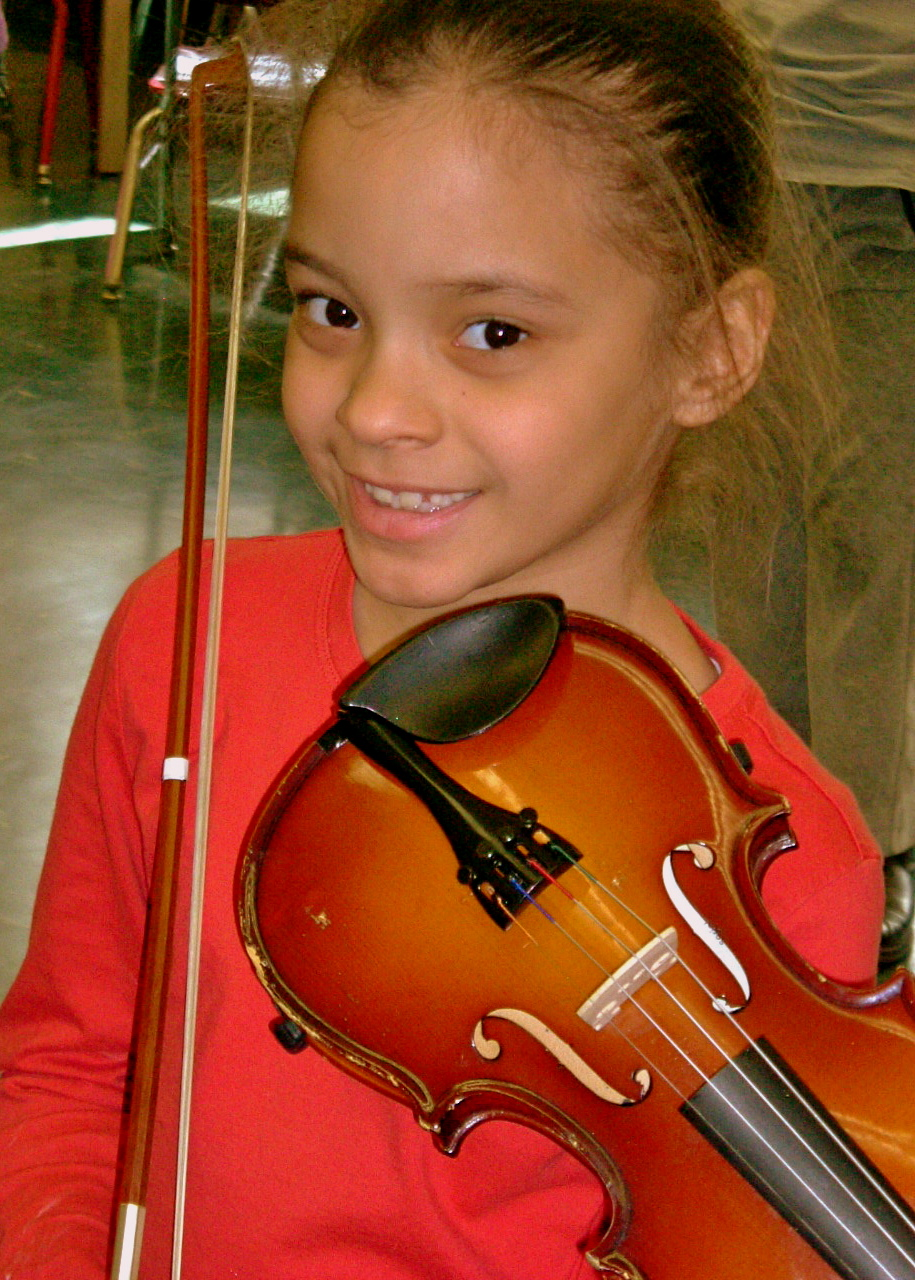 Look at that smile! Learning how to play music can be a lot of fun & boosts confidence!