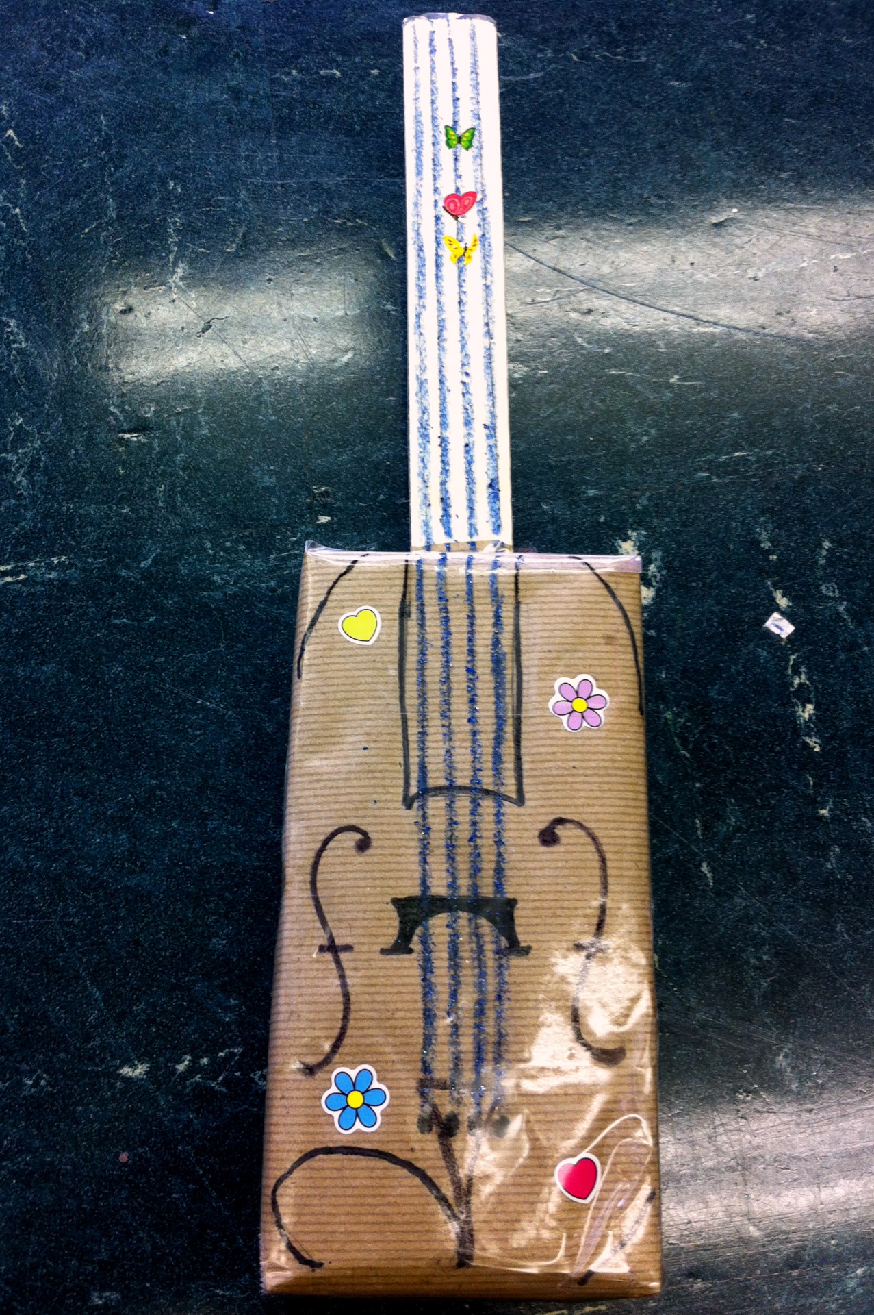 An adorable box violin is the perfect tool to start using when teaching youngsters how to play the violin!