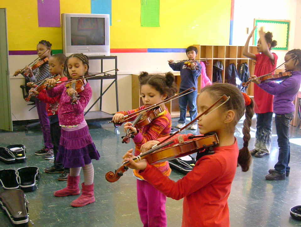 Rebecca Cherry's violin class. Look at how focused they are! In addition to private lessons, Red Rabbit Music offers in-school and after school programming for instrumental group classes, and multi-discipline classes through our STARS program. Contact us to get started! schools@redrabbitmusicnyc.com