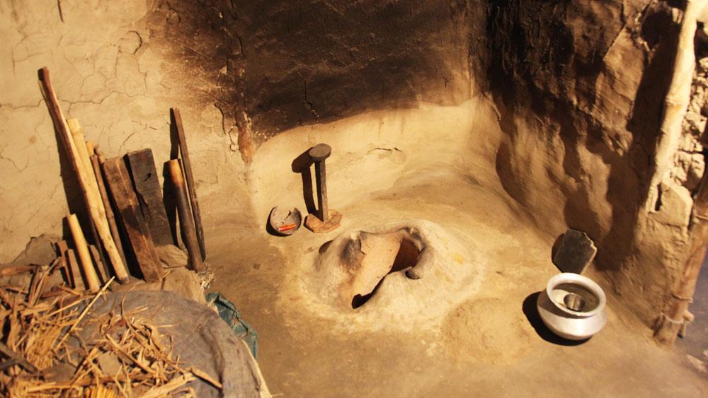 Earthen floor, stove and walls