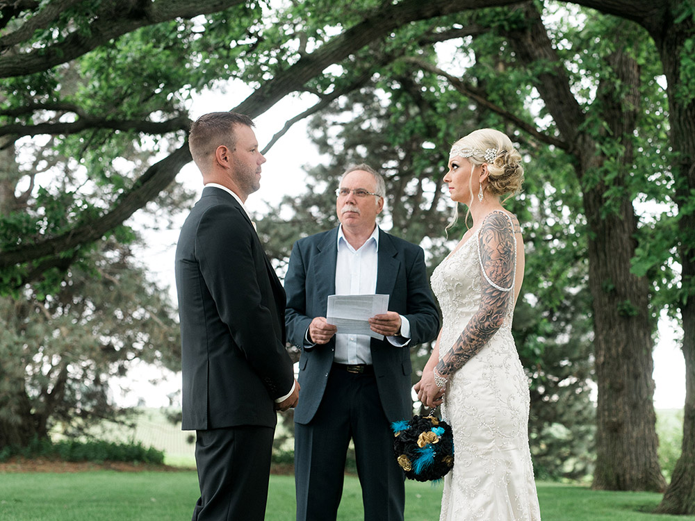 back yard wedding small wedding officiant beaded gown waterloo ia wedding photography.jpg