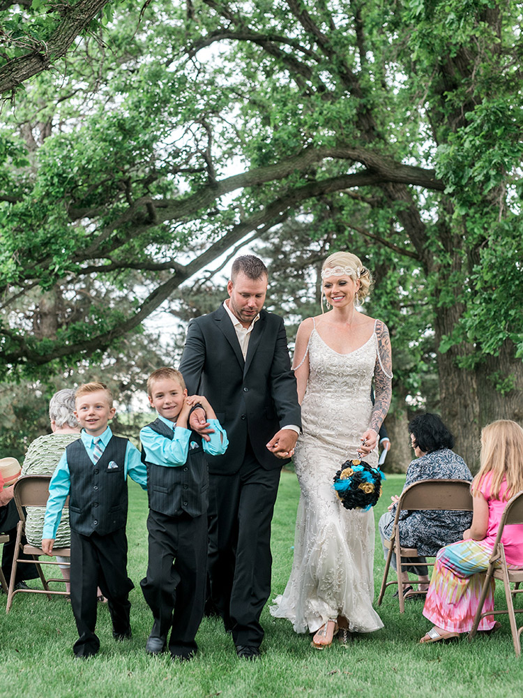 backyard wedding small wedding  black and teal beaded gown waterloo ia wedding photography.jpg