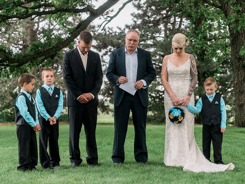 backyard wedding small wedding  wedding prayer waterloo ia wedding photography.jpg