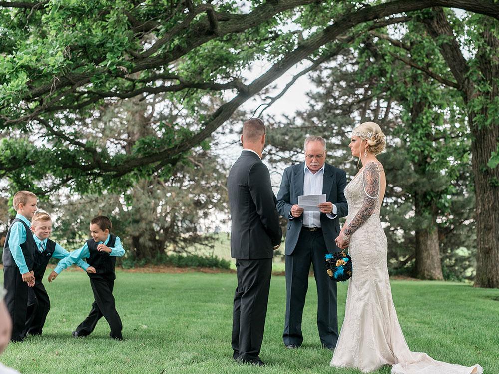 backyard wedding small wedding adorable groomsmen teal and black beaded gown waterloo ia wedding photography.jpg