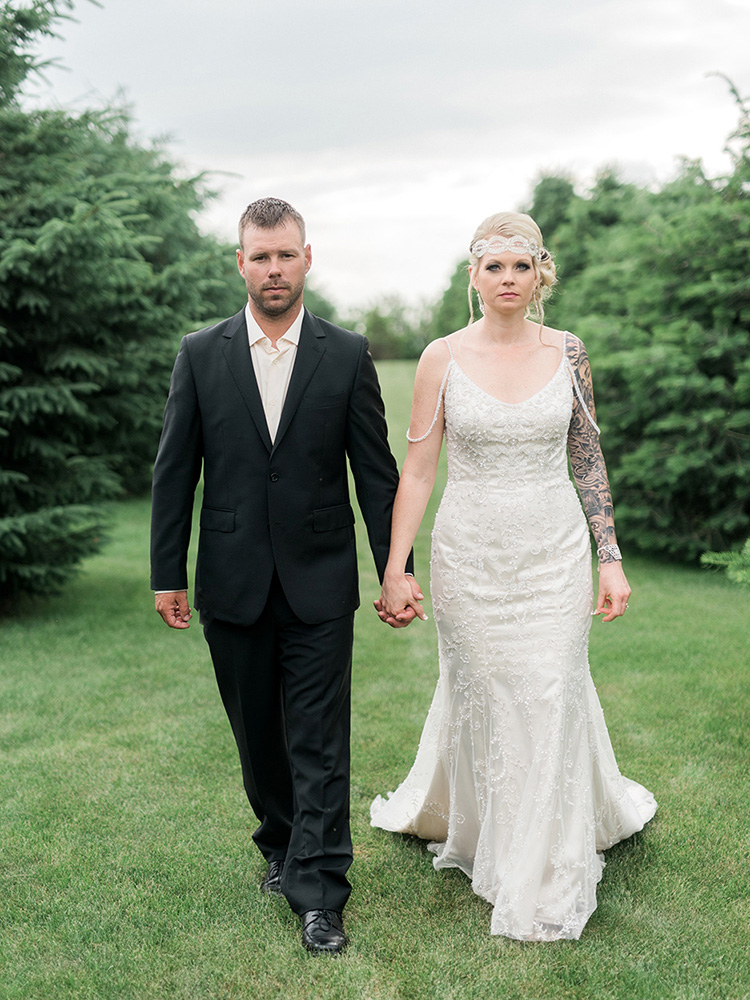 backyard wedding small wedding tattood bride black suit beaded gown waterloo ia wedding photographer.jpg