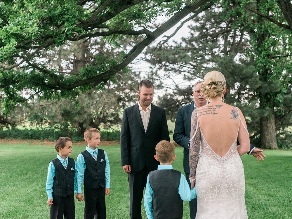 backyard wedding small wedding teal black and gold beaded gown tattood bride waterloo ia wedding photography.jpg