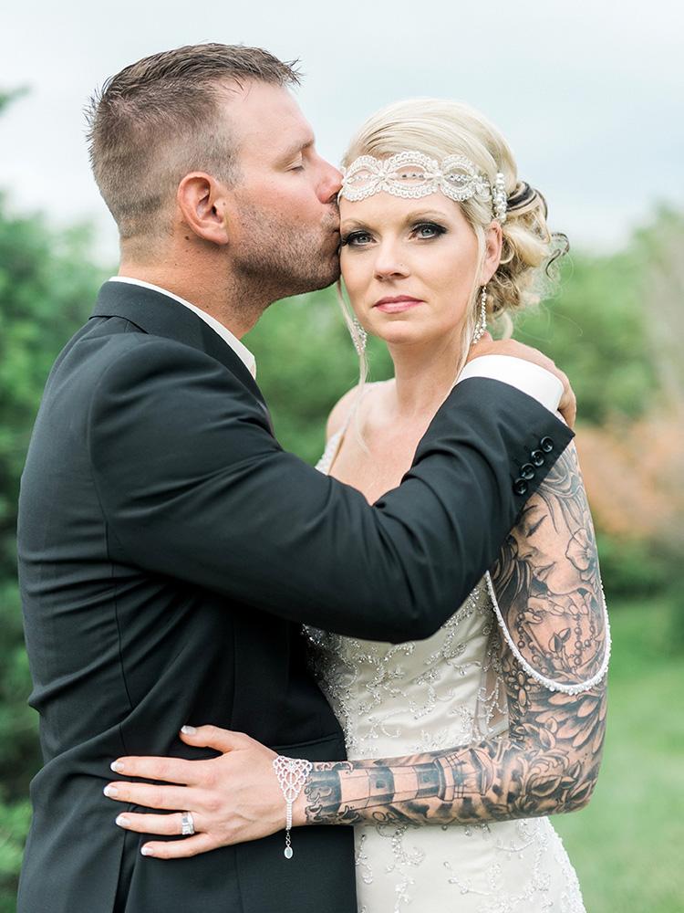 backyard wedding small wedding tattood bride vinatge waterloo ia wedding photography.jpg