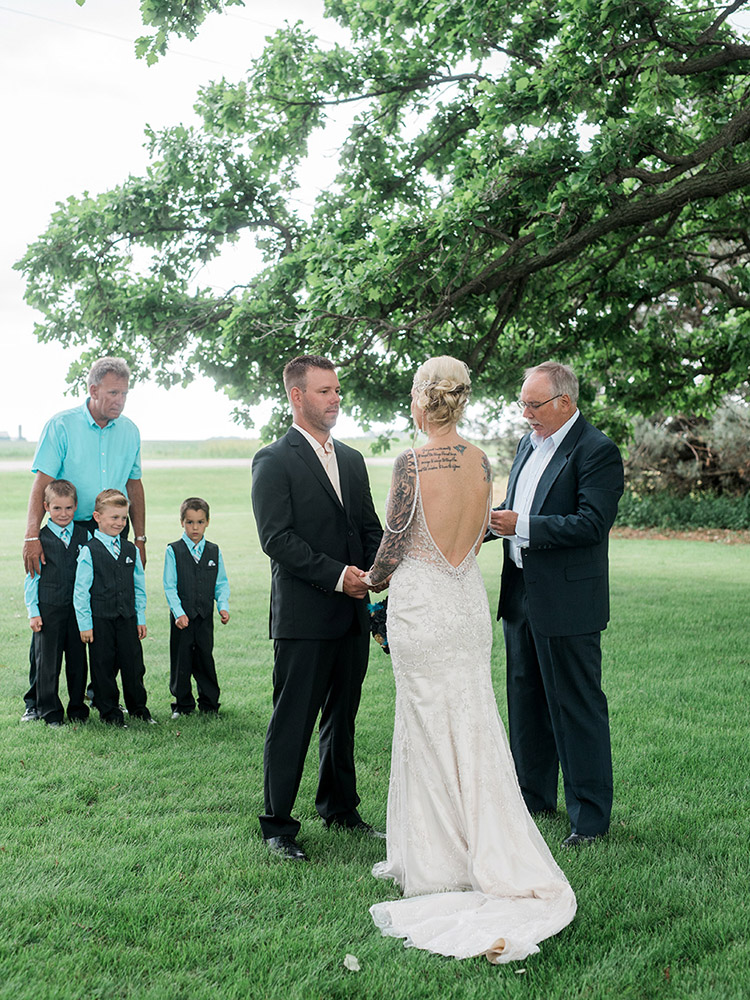 backyard wedding small wedding vows waterloo ia wedding photography.jpg