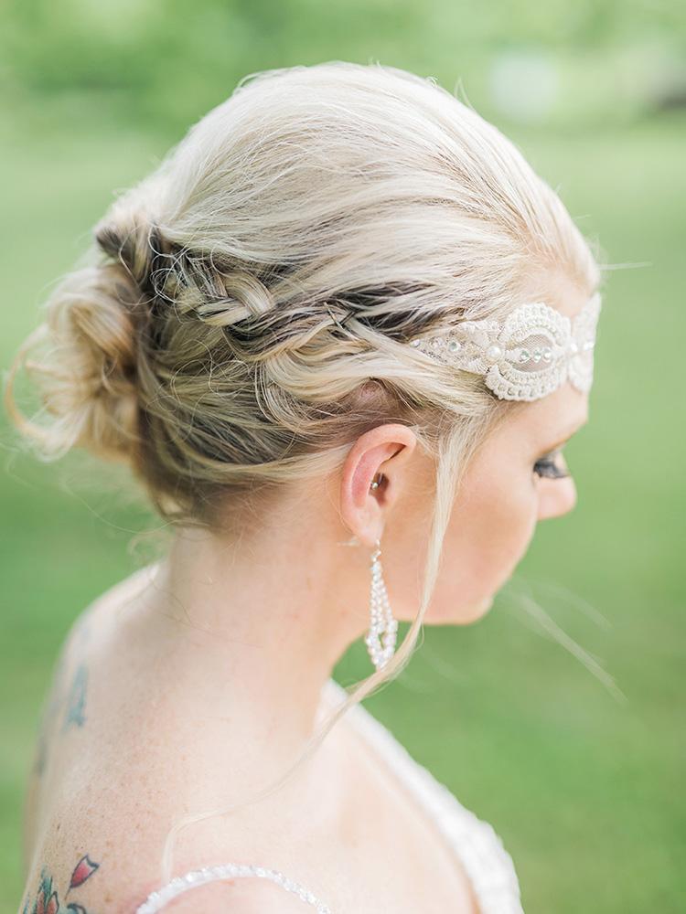 braided updo blonde with black streaks tattood bride  waterloo cedar falls ia wedding photographer.jpg