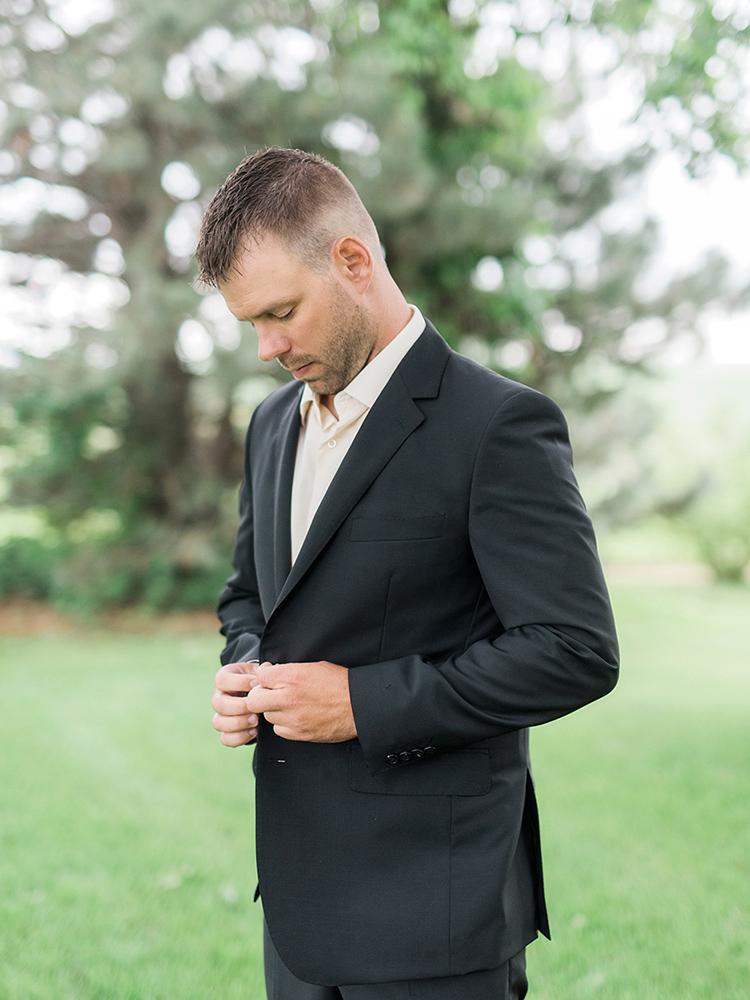 groom black suit waterloo ia wedding photography.jpg