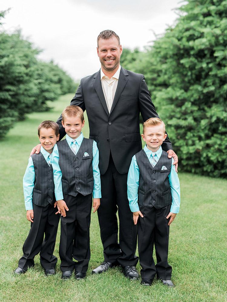 groomsmen striped vest groom black tux waterloo ia wedding photography.jpg