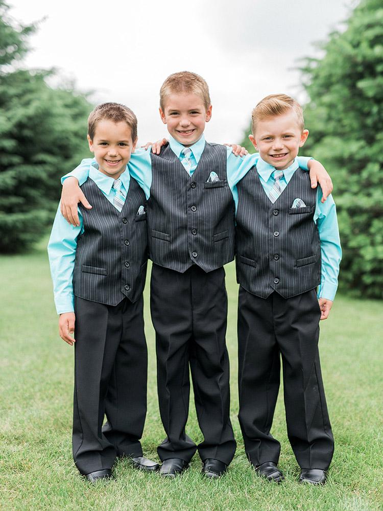groomsmen striped vest teal wedding photography waterloo ia.jpg