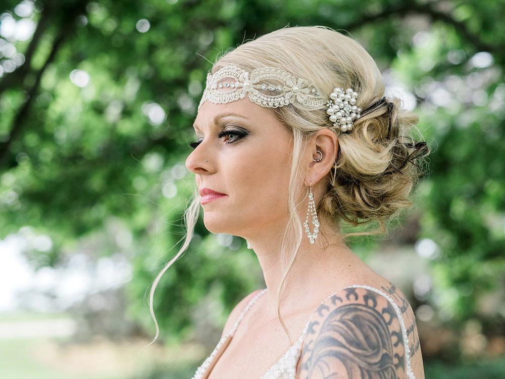 rock n roll bride diamond earings lace headpiece pearl hairclip waterloo ia wedding photographer.jpg