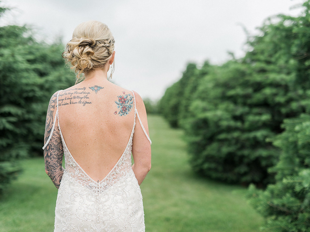 tatood bride vintage gown braided updo waterloo ia wedding photographer.jpg