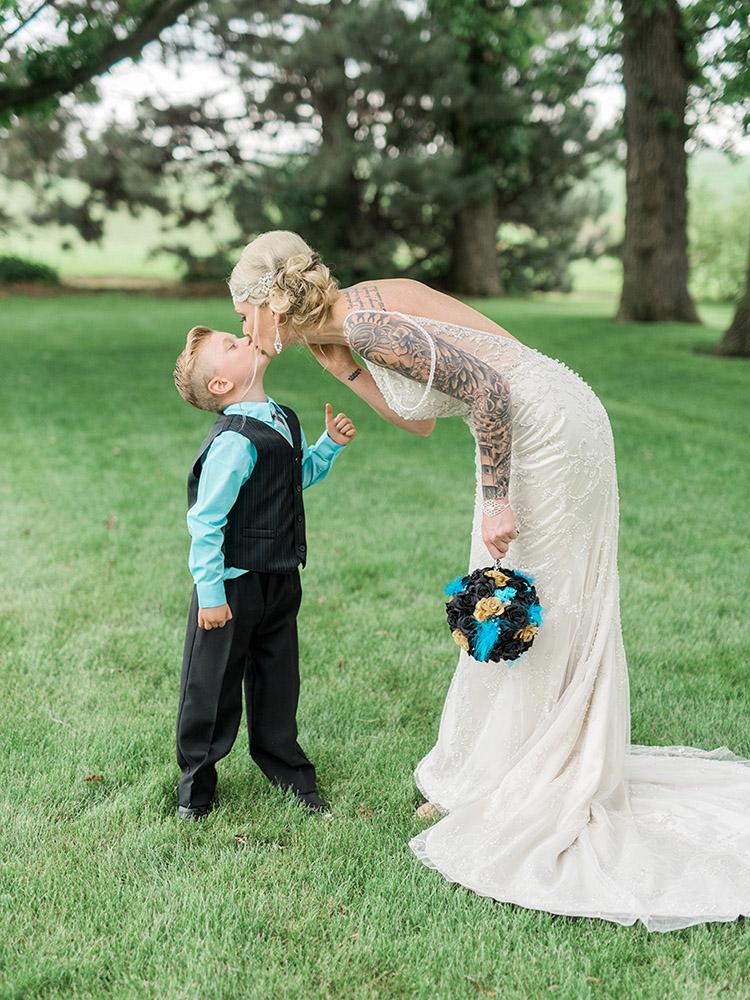 tattood bride beaded gown DIY bouquet vintage gown adorable kiss waterloo ia wedding photographer.jpg