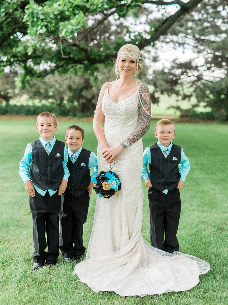 tattood bride beaded gown groomsmen teal striped vest waterloo ia wedding photographer.jpg
