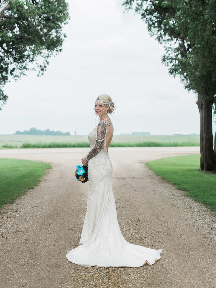 tattood bride beaded gown wedding updo waterloo ia wedding photographer.jpg