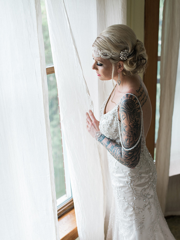 tattood bride beaded gown vintage gown pearl hair clip waterloo ia wedding photographer.jpg