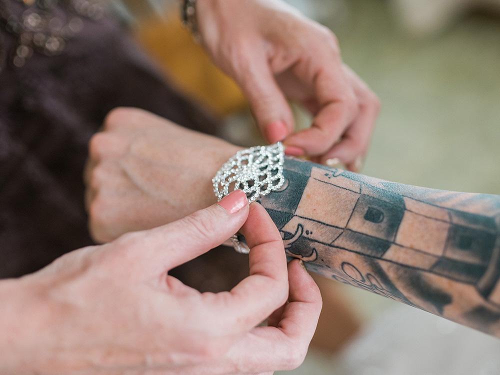 tattood bride diamond bracelet waterloo ia wedding photography.jpg