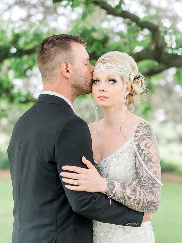 wedding updo tattood bride beaded gown black suit waterloo ia wedding photography.jpg