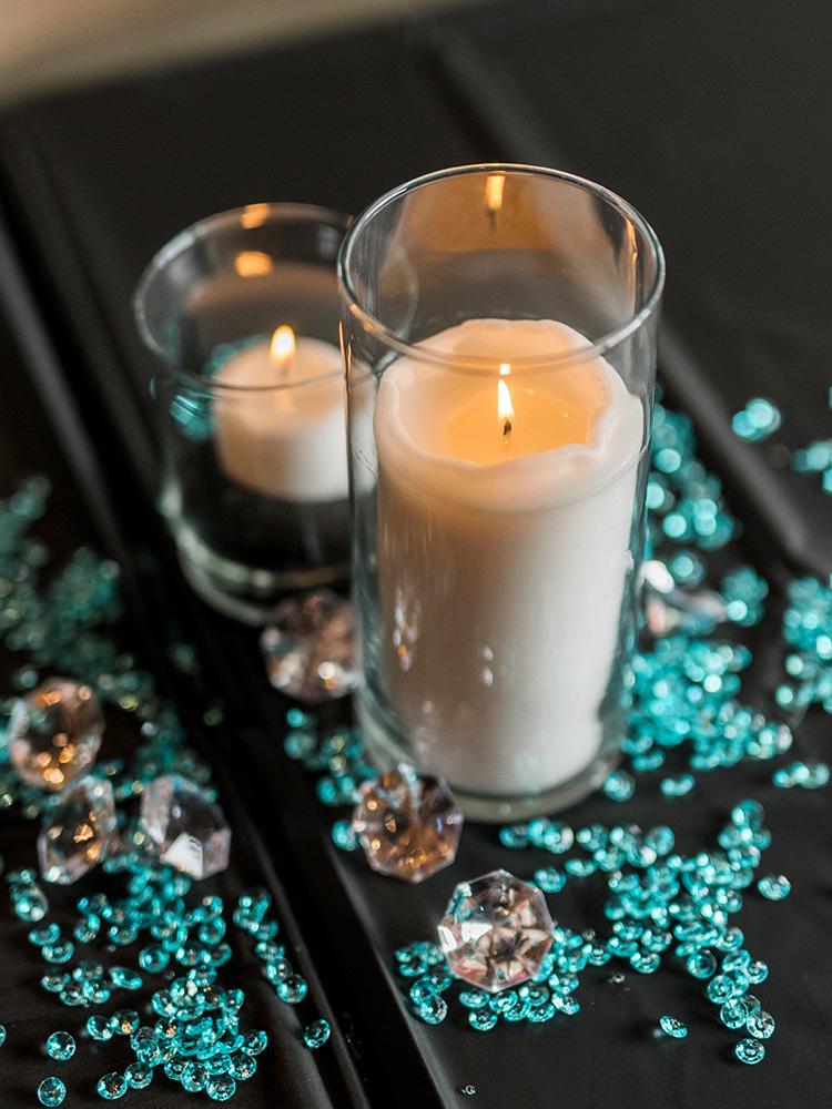 glass beads teal and black candles wedding reception center pieces  waterloo cedar falls ia wedding photographer.jpg