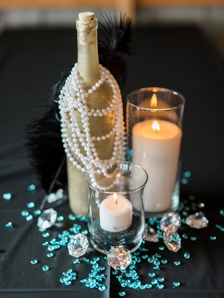 glitter bottles candles feathers glass beads reception centerpieces  waterloo cedar falls ia wedding photographer.jpg