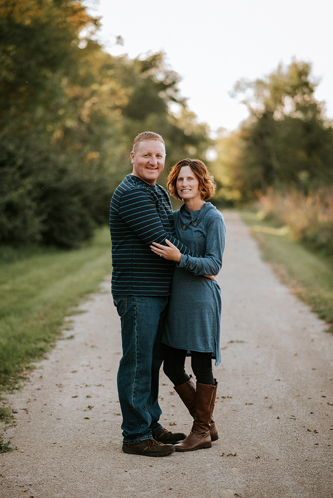 nicole corrine family portrait photographer iowa midwest happy couple.jpg
