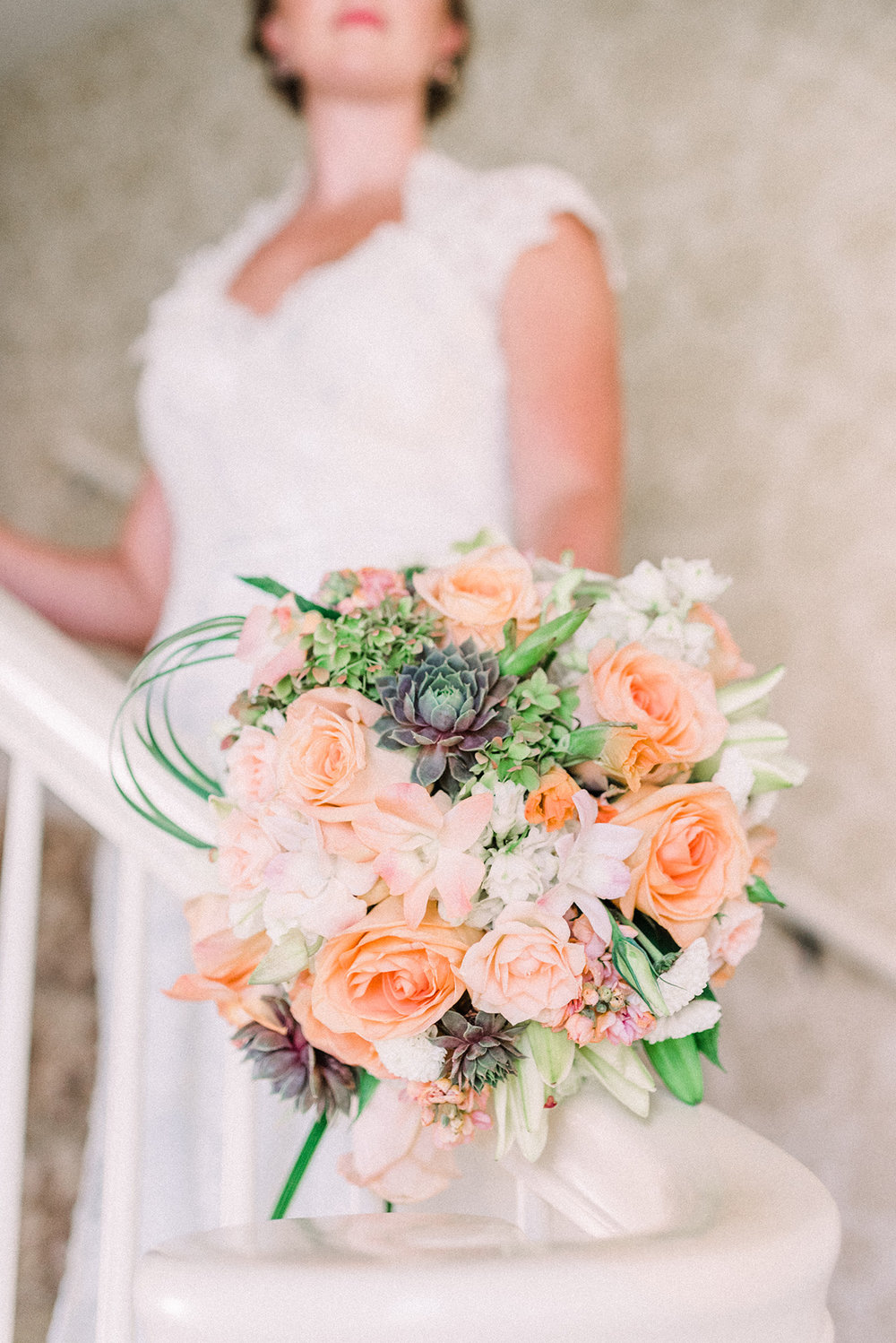 Beautiful wedding floral arrangement at snowden house in waterloo, ia