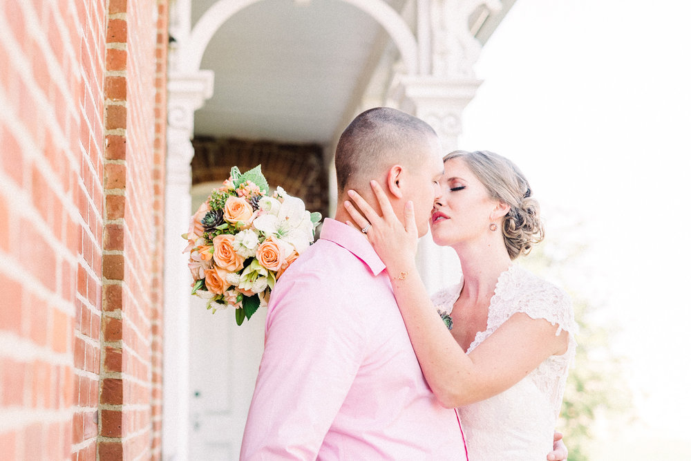 Outside of the Snowden House a Bride and groom kiss.