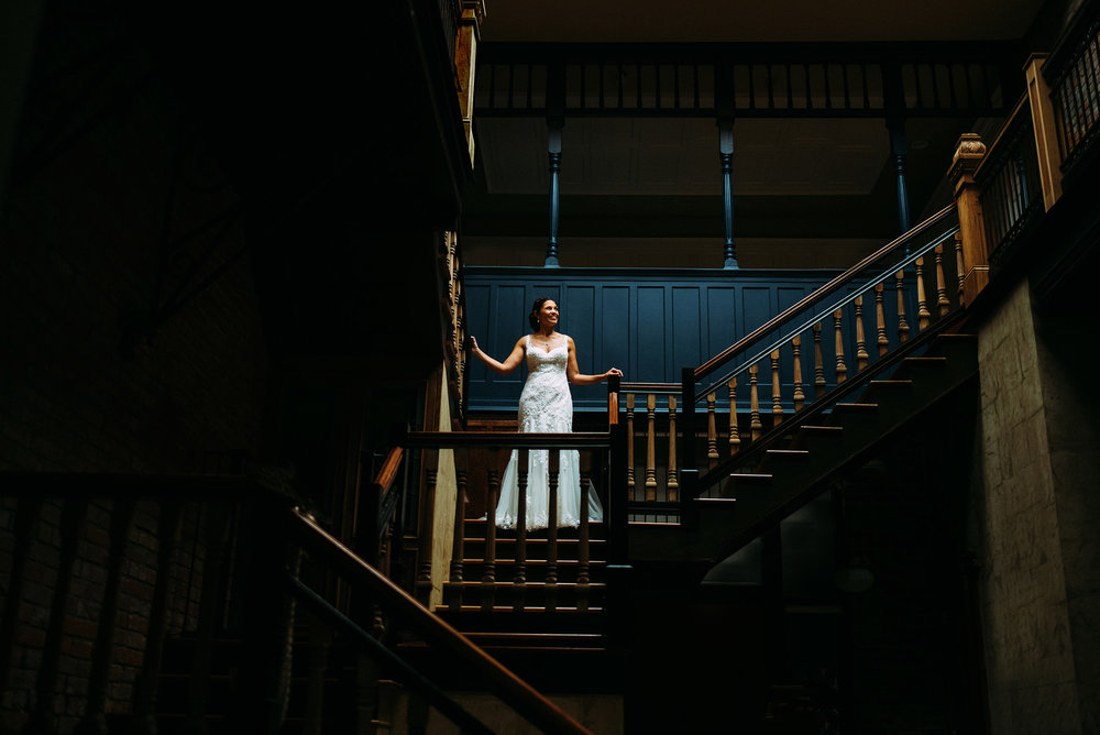 bridal portrait on staircase at Lucile's Old Market in Omaha, NE