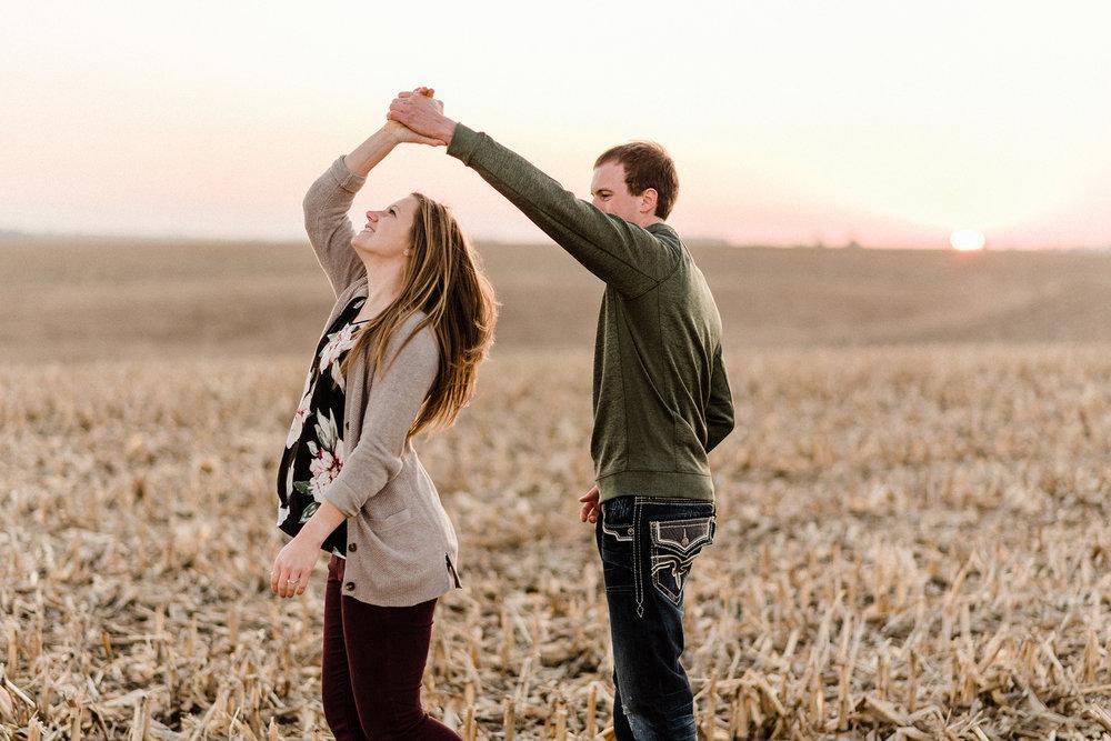 Nicole Corrine Iowa Wwdding Photographer Farm Engagement Session twirl.jpg