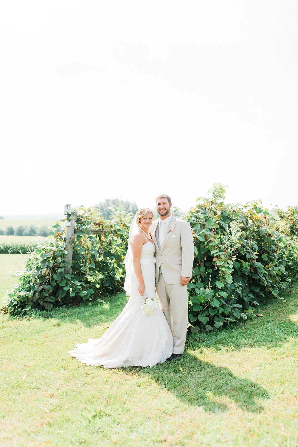 Bride and groom at a vineyard wedding in Traer, IA