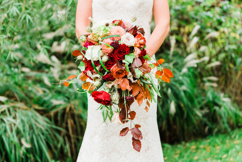 Gorgeous fall bridal bouquet. Reds, oranges, greens, fall leaves.