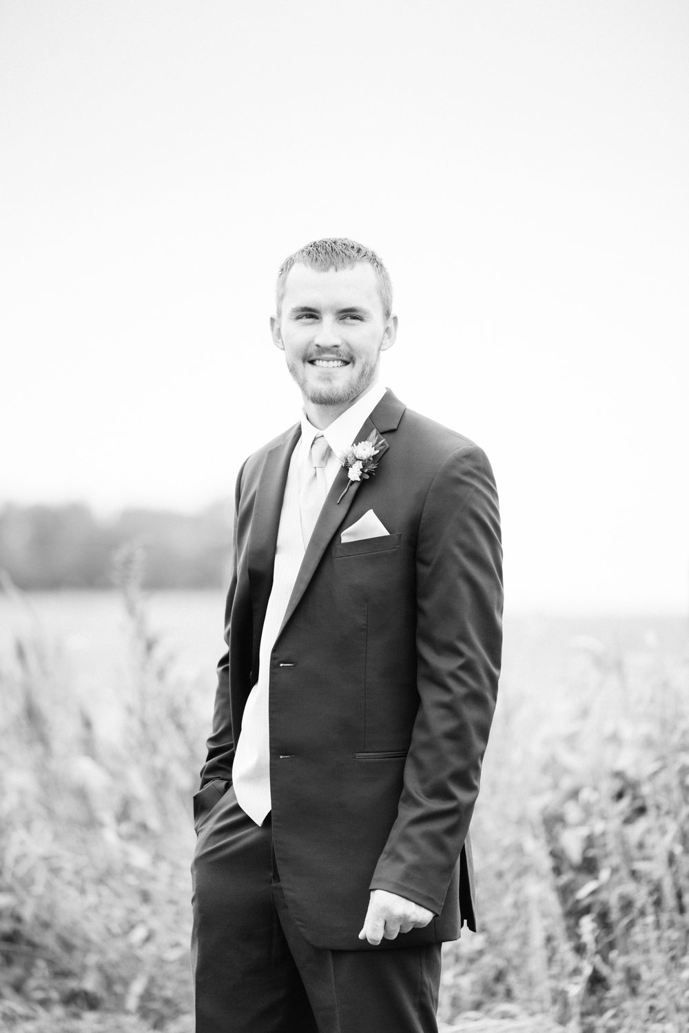 black and white photo of a groom on his wedding day in Iowa