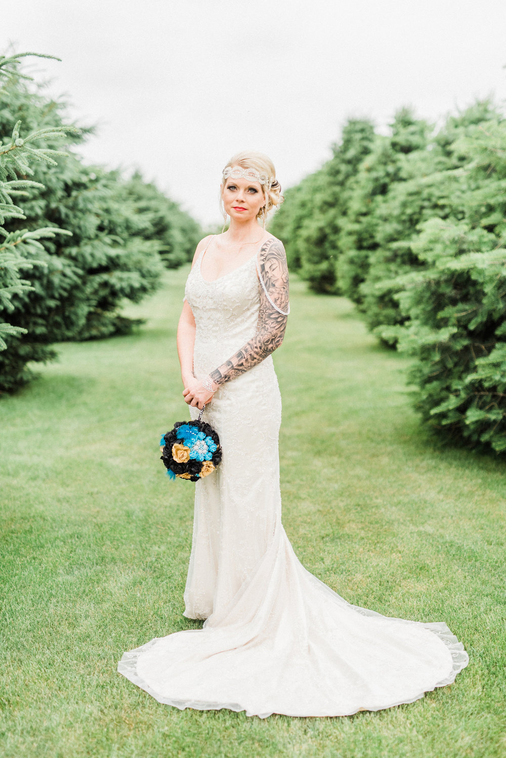 Bride posing in natural light with tattoos. Great Gatsby style wedding