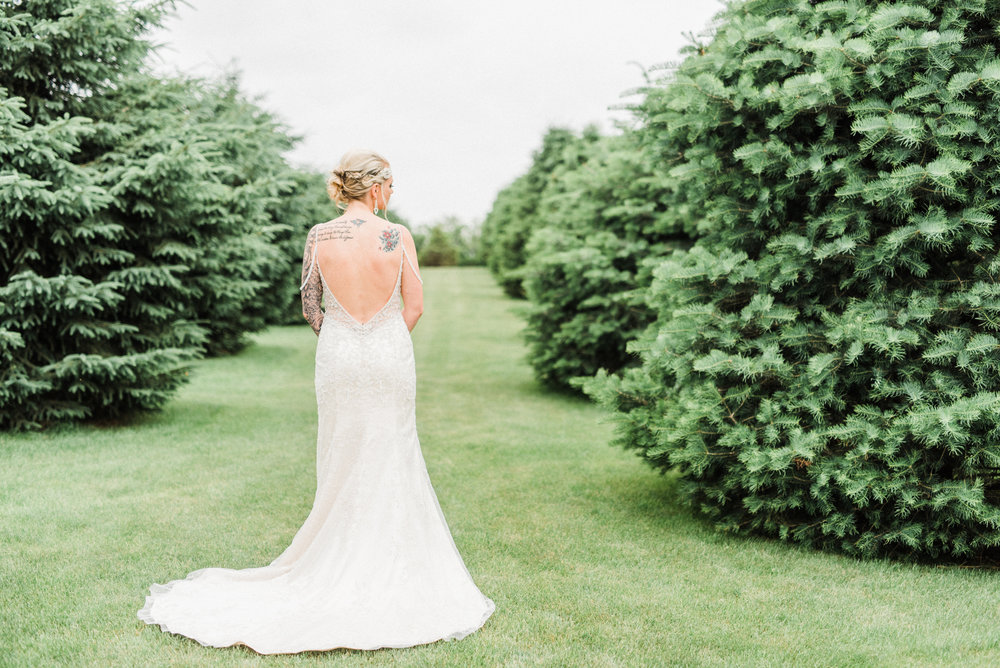 tattooed bride showing the back of her dress. Reinbeck, IA