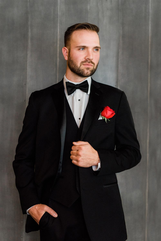 Handsome groom posing in the Cellar in Waterloo, IA