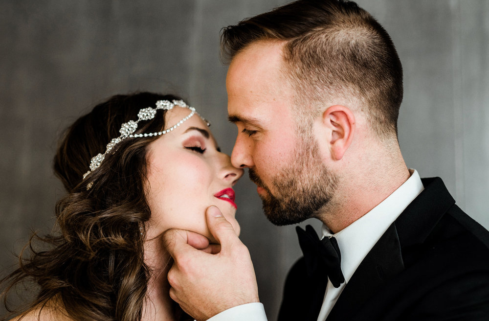 Romantic kiss shared between a bride and groom at The Cellar in Iowa