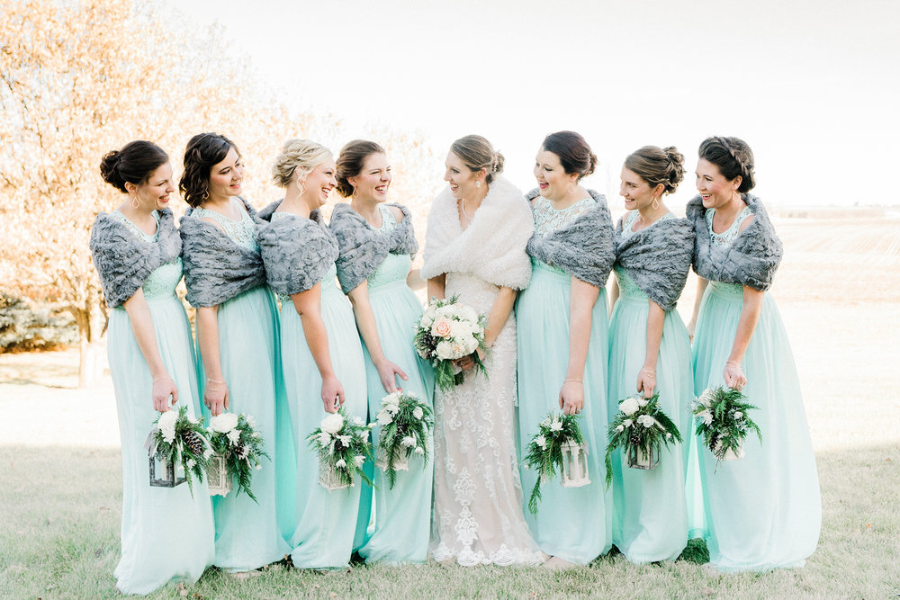 Winter bridal party with their gorgeous winter floral lanterns in Great Mills, IA